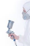 Arbeider met luchtpenseelkanon royalty-vrije stock foto