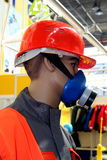 Arbeider met masker Stock Foto's