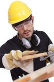 Arbeider met schuurpapier Stock Foto's