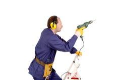 Arbeider op ladder met boor stock foto's