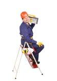 Arbeider op ladder met toolbox stock foto's