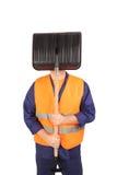 Arbeider in weerspiegelend vest verbergend gezicht stock foto's