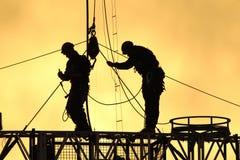 Arbeiders 01 van Silhouettte Stock Foto's