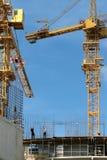 Arbeiders en kraan Stock Foto