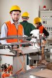Arbeiders in fabriek royalty-vrije stock foto's