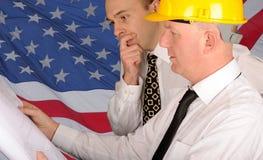Arbeiders met Plannen Royalty-vrije Stock Afbeeldingen