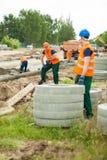 Arbeiders op bouwwerf Stock Afbeelding