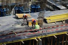 Arbeiders op een bouwwerf Stock Fotografie