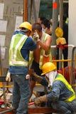 Arbeiders op het Niveau van de Straat Stock Foto