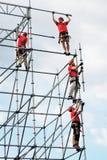 Arbeiders in rode eenvormig Stock Foto's