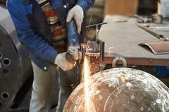Arbeiders scherp metaal stock foto's