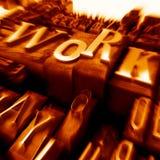 Arbeit in den DruckBuchstabenlagen in der Orange Stockbild