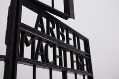 Arbeit Macht Frei. The famous and historically significant ¨Arbeit Macht Frei¨ across the main gates at Station A of Sachsenhausen Concentration Camp Stock Image