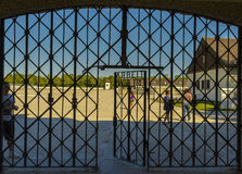 Arbeit macht frei gate entrance. With unidentified people who visit the concentration camp on August 29, 2015 in Dachau, Bavaria, Germany Stock Photos