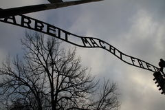 Arbeit macht frei. Historic sign in Auschwitz concentration camp Stock Photo