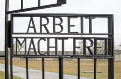 Arbeit Macht Frei - Sachsenhausen National Memorial. Inscription ARBEIT MACHT FREI on the gates to the former Nazi concentration camp, now the Sachsenhausen Royalty Free Stock Images