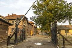 Arbeit macht frei sign in Auschwitz I concentration camp, Oswiec. AUSCHWITZ, POLAND - AUGUST 27, 2017. Arbeit macht frei sign on the main entrance gateway to Royalty Free Stock Images