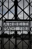 Arbeit macht frei Work sets you free sign on Nazi`s Dachau Concentration Camp gate stock photos