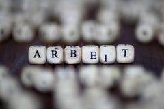 ARBEIT-ord med kvarter begrepp för tärning för jobbaffärsledarskap Royaltyfri Foto