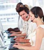 Arbeiten in einer Aufrufmitte Lizenzfreies Stockbild