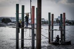 Arbeiten im Fluss Stockfotos