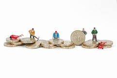 Arbeiten mit Geld Lizenzfreie Stockfotos