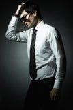 Arbeiten Sie Portrait des jungen Geschäftsmannes um Stockfoto