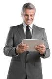 Arbeiten an Tablette Lizenzfreie Stockfotos