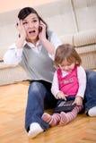 Arbeiten und parenting Lizenzfreies Stockbild