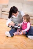 Arbeiten und parenting Stockfoto