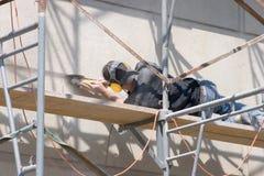 Arbeiter, der Wall_7895-1S reibt Stockbild