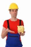 Arbeiter mit Sparschwein Lizenzfreies Stockfoto