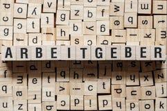 Arbeitgeber - ordarbetsgivare på tyskt språk, ordbegrepp arkivfoto