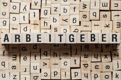 Arbeitgeber - woordwerkgever op duitstalig, woordconcept stock foto