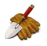 Arbeits-Handschuhe und Schaufel stockfotos