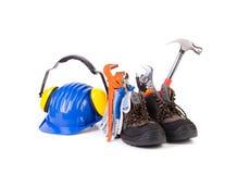 Arbeitsgeräte in den Stiefeln Stockfotos
