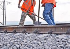 Arbeitskräfte in den orange Westen lizenzfreie stockbilder