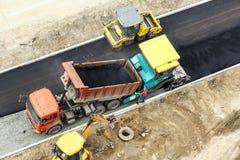 Arbeitskräfte, die Straße konstruieren stockfoto
