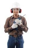 Arbeitskräfte lächeln beim Anhalten des Bohrgeräts mit beiden Händen Stockfoto