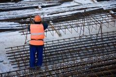 Arbeitskraft auf Baustelle Lizenzfreies Stockbild