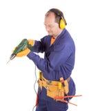Arbeitskraft auf Leiter mit Bohrgerät Stockfotos