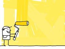 Arbeitskraft, die einen gelben Hintergrund malt Stockfoto