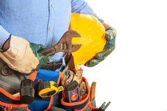 Arbeitskraft, die einen Schlüssel anhält Stockfotografie