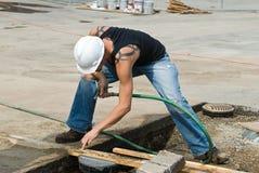 Arbeitskraft, die Platzierung überprüft Lizenzfreies Stockfoto
