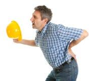 Arbeitskraft, die unter den Schmerz in der Rückseite leidet Stockbild