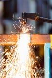 Arbeitskraft justieren Acetylenfackel Lizenzfreie Stockfotos
