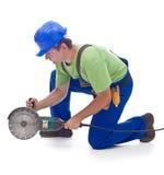 Arbeitskraft mit einem Energieschleifer Lizenzfreie Stockbilder