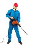 Arbeitskraft mit einem Hammerbohrgerät auf weißem Hintergrund Stockbild