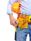 Arbeitskraft mit einem Werkzeuggurt. Stockbilder
