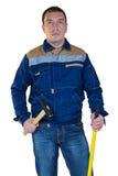 Arbeitskraft mit Hammer in seiner Hand Lizenzfreies Stockbild